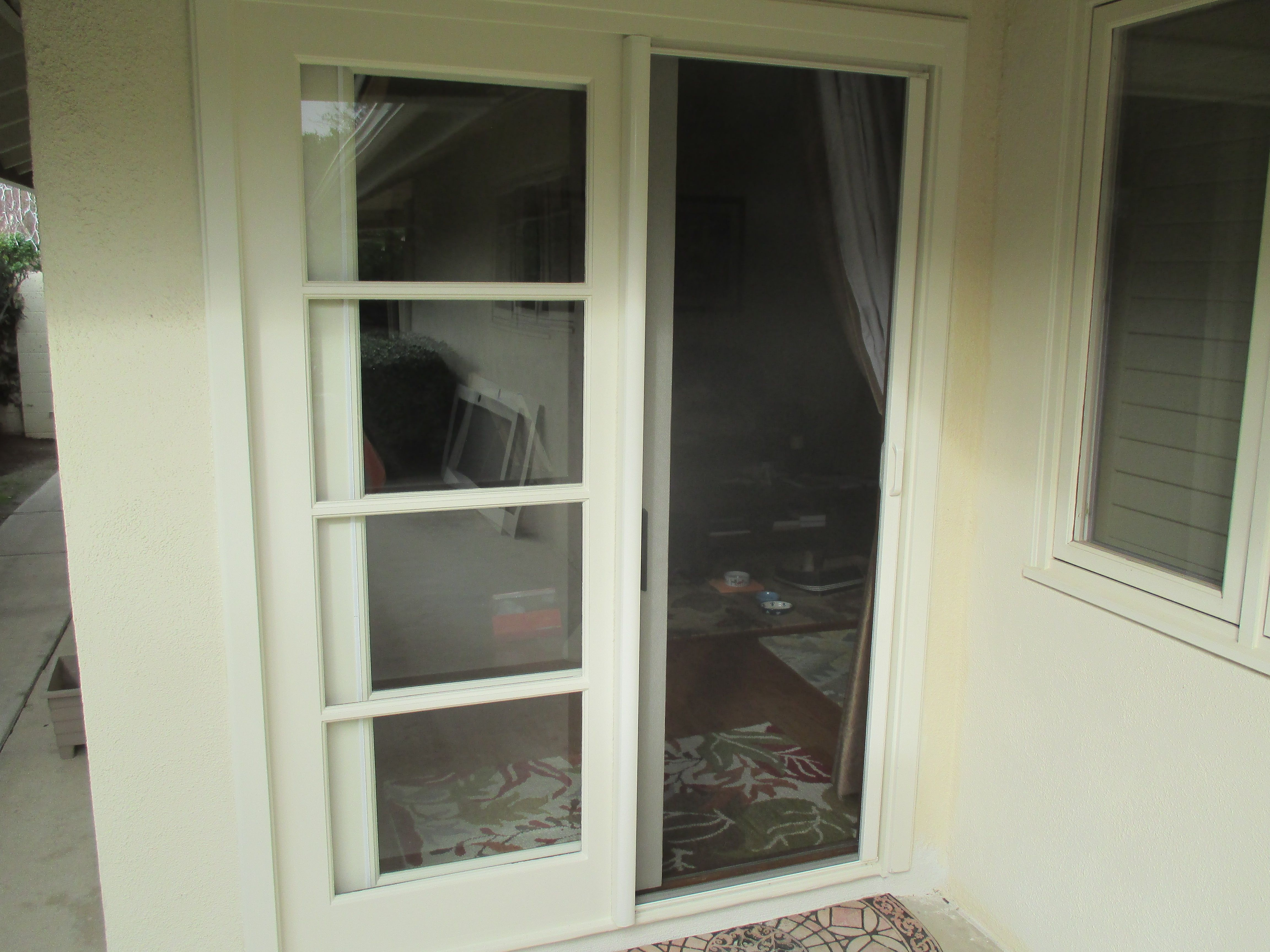 Here We Have A White Single Stowaway Retractable Screen Door W