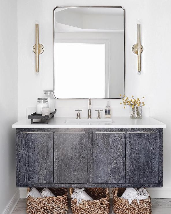 Satin Nickel Sconces Illuminate A Restoration Hardware Bristol Flat Mirror Placed Over Dark Gray Oak Floating Sink Vanity Topped With White Quartz Fitted