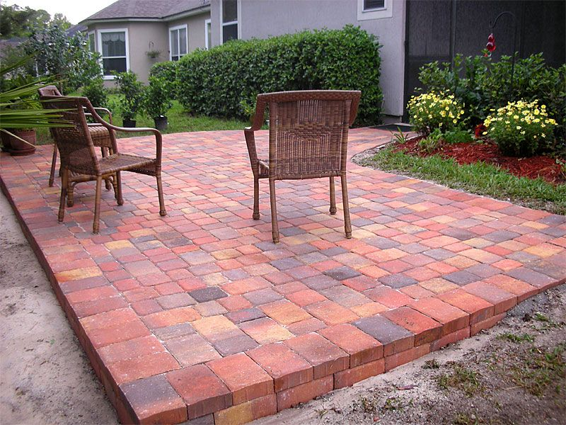 basket weave brick paver patterns for raised patio with stack bone edge  combined with traditional armchairs in garden with plants and grass in  backyard - Basket Weave Brick Paver Patterns For Raised Patio With Stack Bone