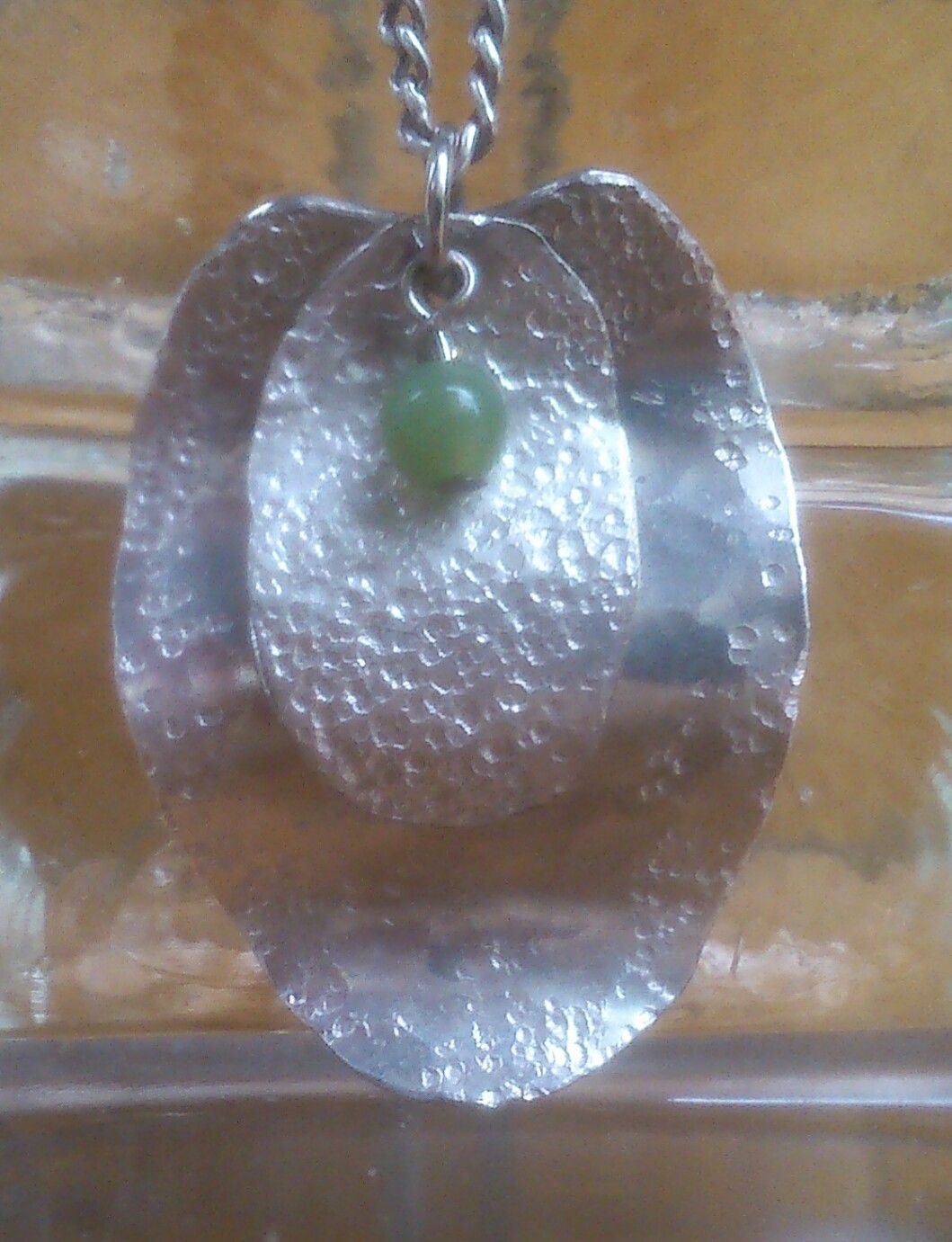 I made this silver spoons with jade bead pendant.  My second piece of 'the wave' creation.  it started out as something totally different...