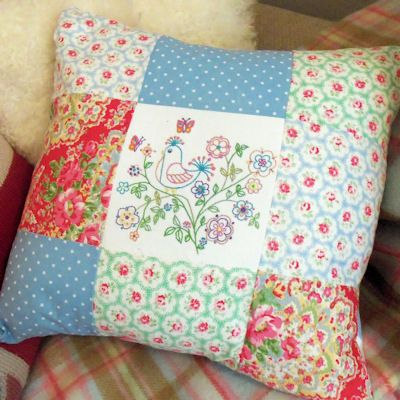 This is a pillow, free embroidery pattern included, but wouldn't it be a cute pincushion...smaller of course.