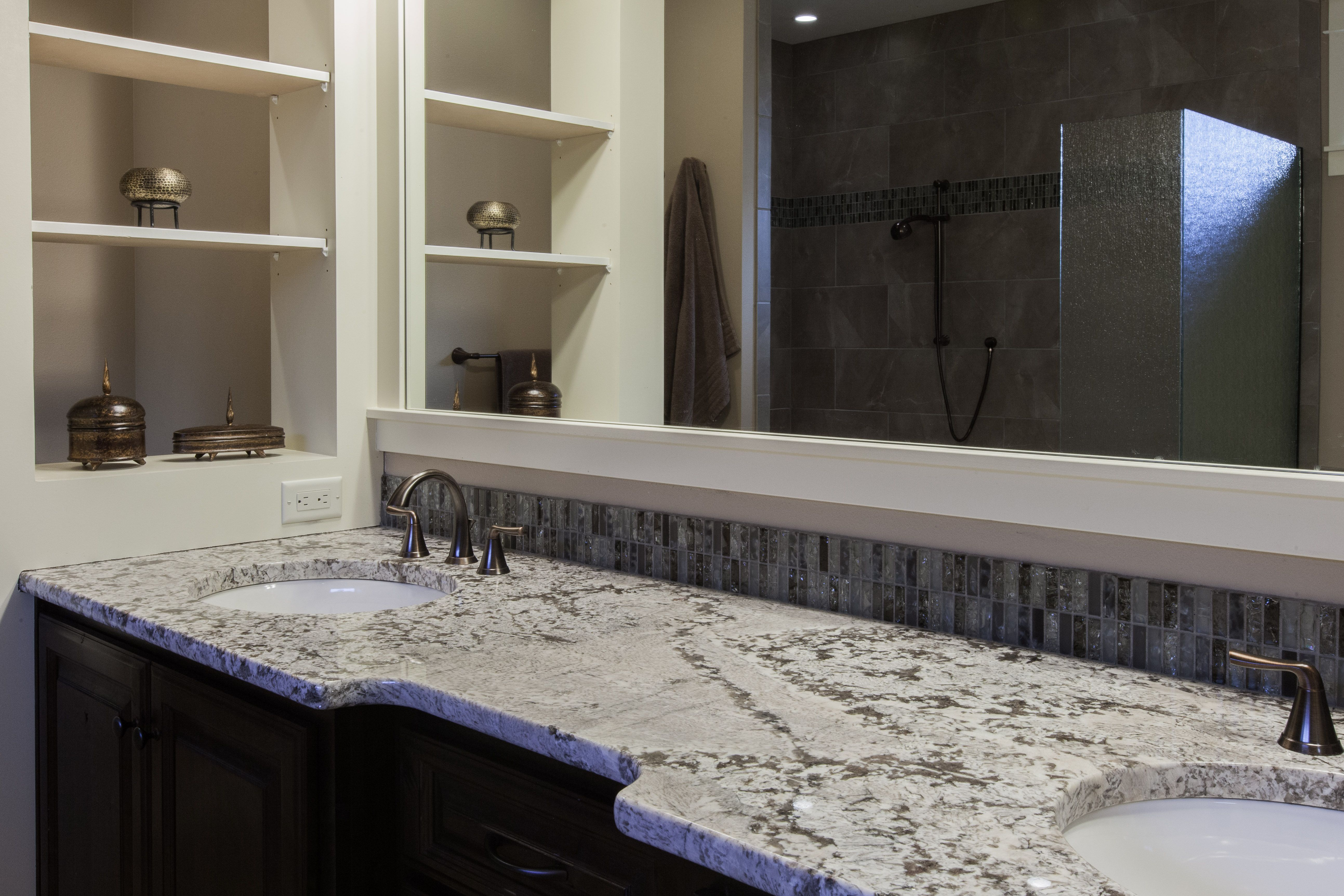Dual sinks in the master bath. Love the counters and tile