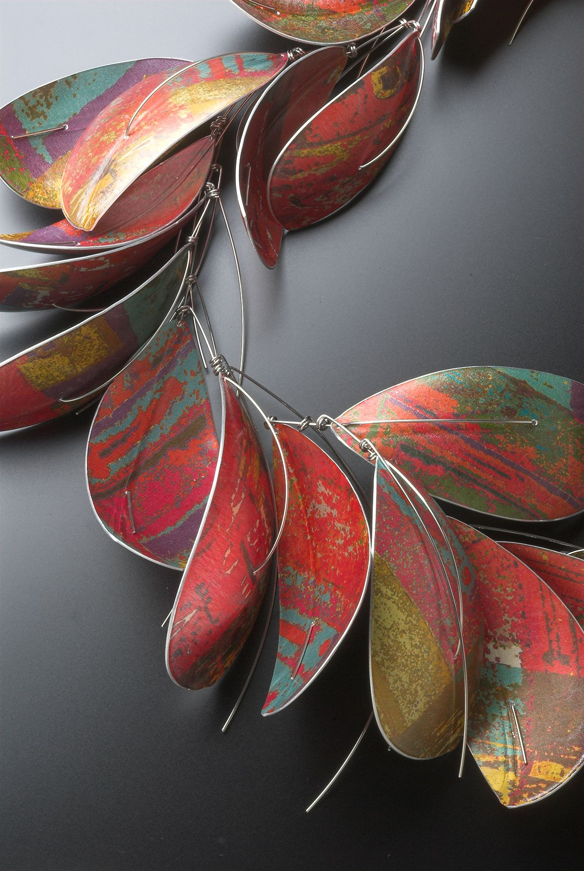 Jane Adam: Large orange leaf necklace. Anodised, dyed and textured aluminium and stainless steel 2013 - 2015Jewellery Ltd