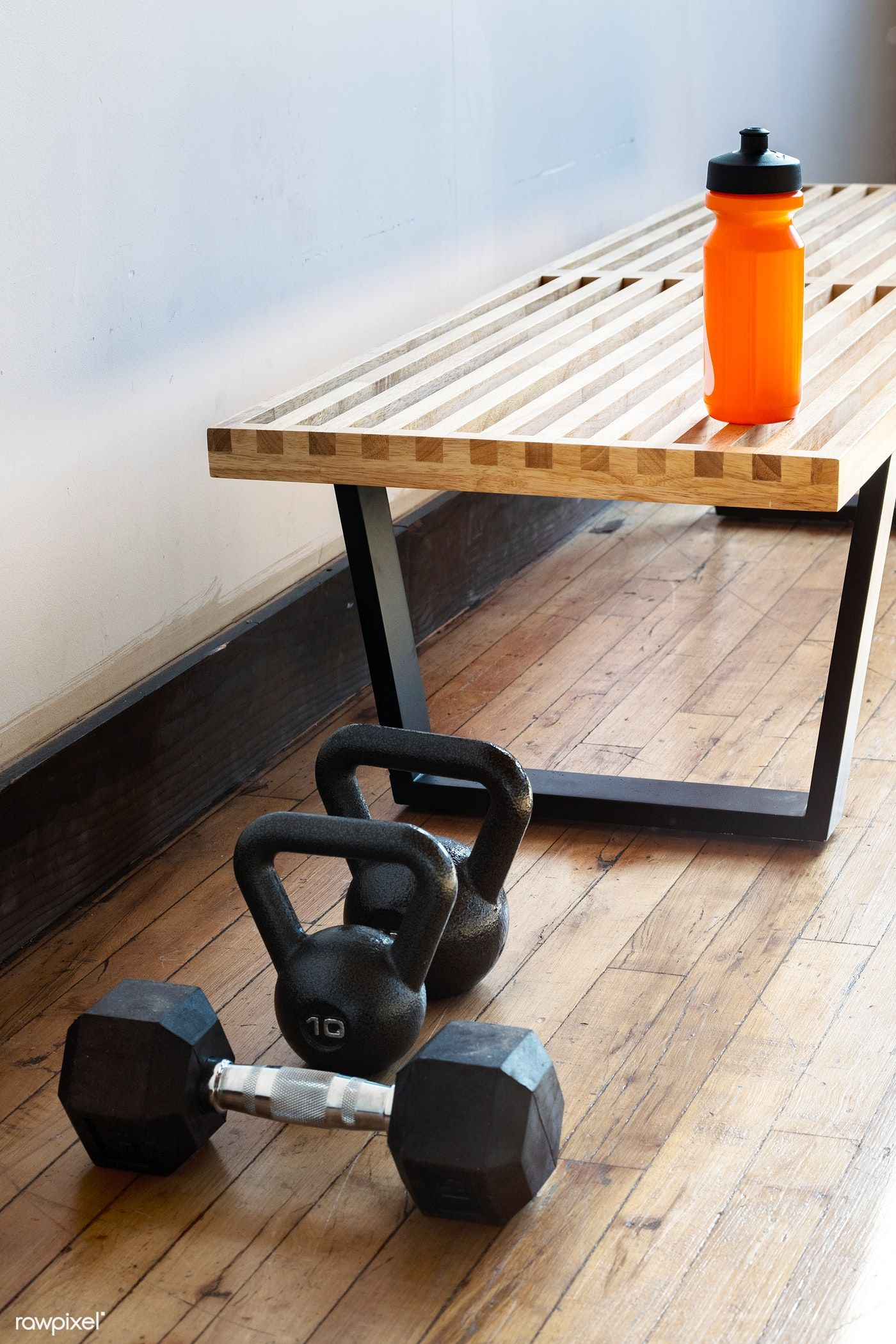 Download premium photo of fitness equipment in a gym