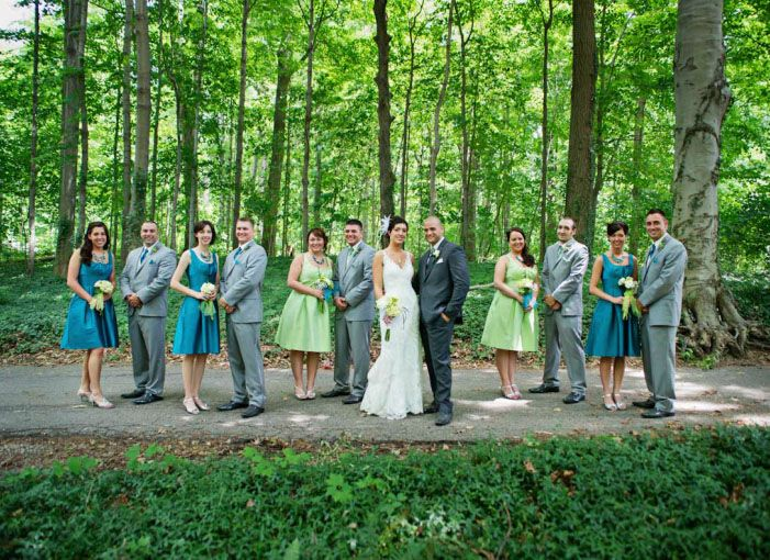 The Wedding Party Out On Lush Green Grounds Of Wildwood Cultural Center