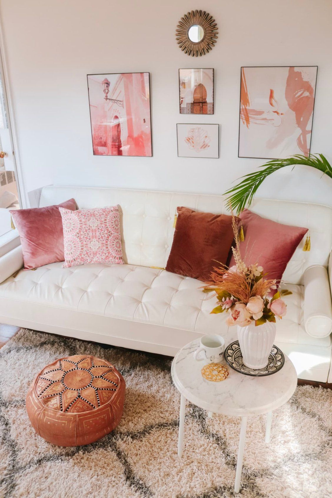 This 500-square-foot NYC studio fits lots of color and texture into a small space without being cluttered. | House Tours by Apartment Therapt #livingroom #boho #livingroomideas #bohemian #bohemiandecor #boholivingroom #pinklivingroom #apartmentdecor #decoratingideas #studioapartment