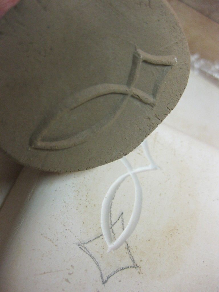 Gary Jackson - making clay stamps by first carving into plaster