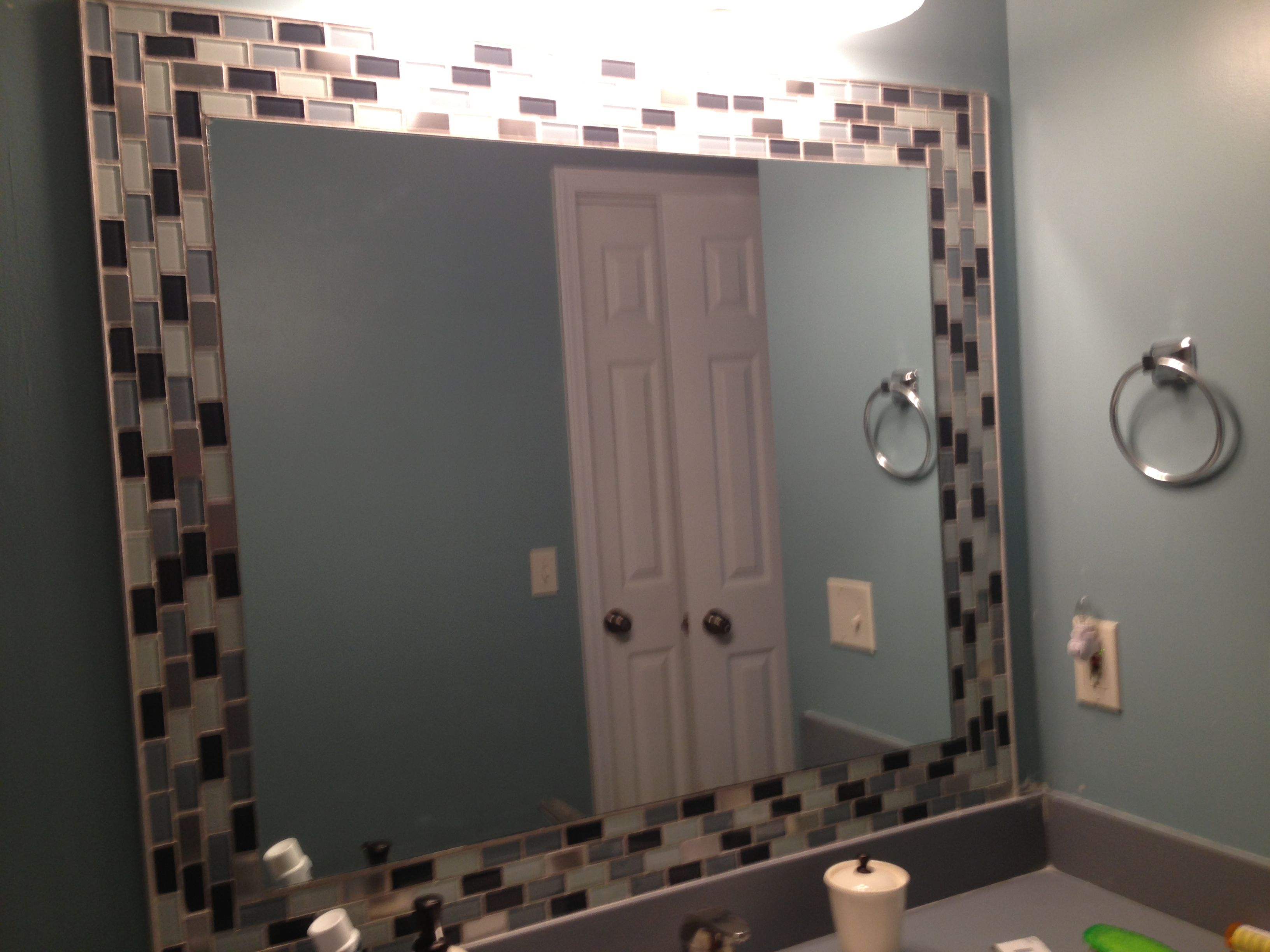 Glass tiles around mirror! Jazzes up any bathroom! So easy