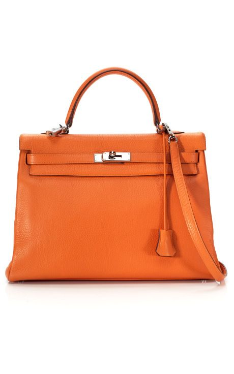 """This Orange H Kelly bag is a bargain, actually, at just $9200. But it just epitomizes the Hermes """"look"""". The """"Hermes Orange"""" is unmistakable!"""
