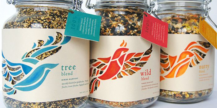 """""""The Wild Birds Unlimited Bird Food packaging was created as a packaging assignment for the rebranding of Wild Birds Unlimited. The idea was to package bird food that brought out the organic texture and natural color of the bird seeds, accomplished with the use of jars. The jars are perfect for display and storage purposes, because they fit well in any space."""