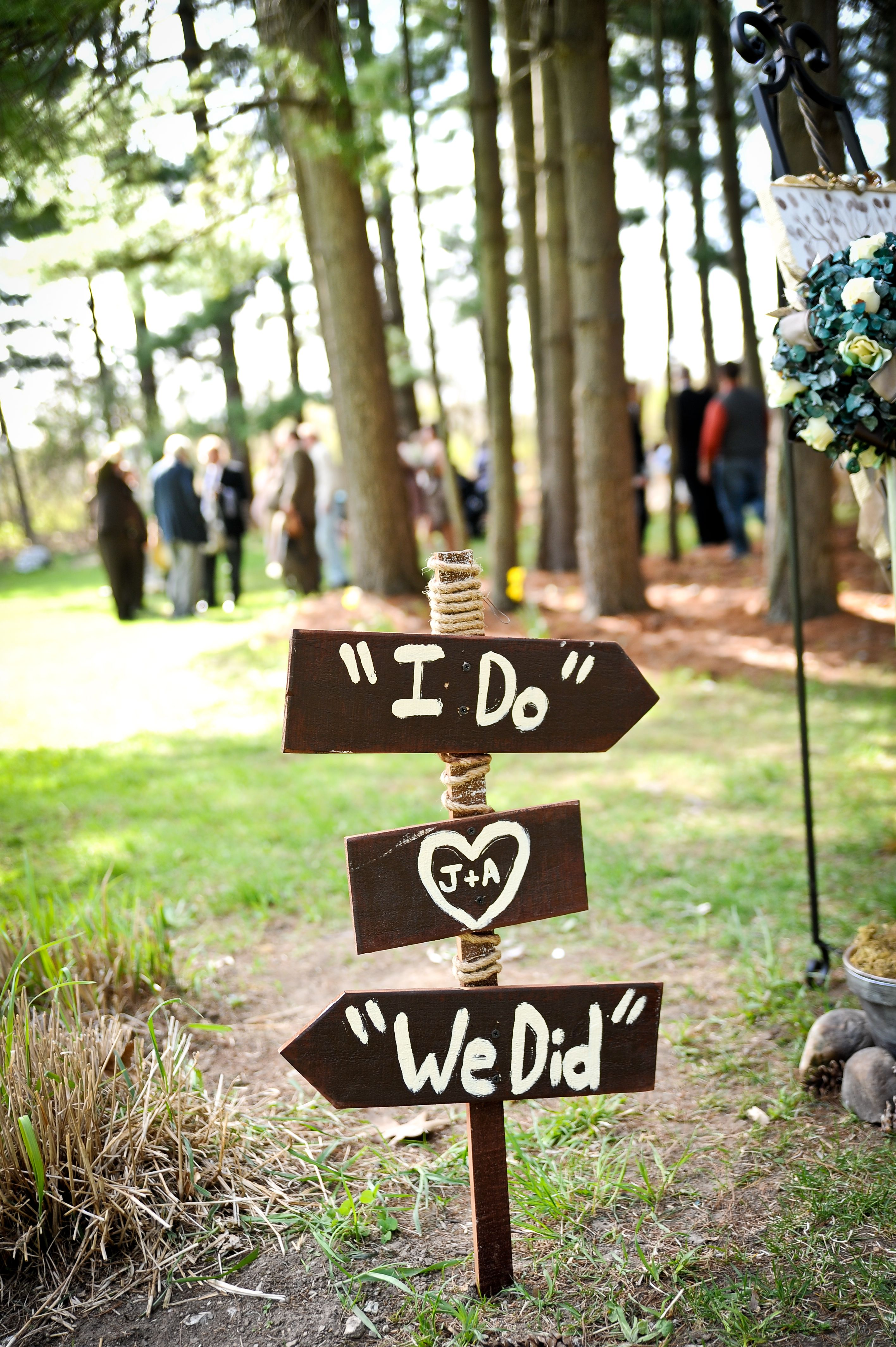 Sign pointing to the ceremony and reception rustic wedding diy