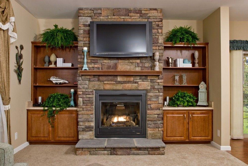 full wall fireplace with bookcases on each side great