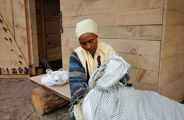 Kitty Wilson-Evans portrays the slave Kessie during the Under the Crown event in June at the Living History Park