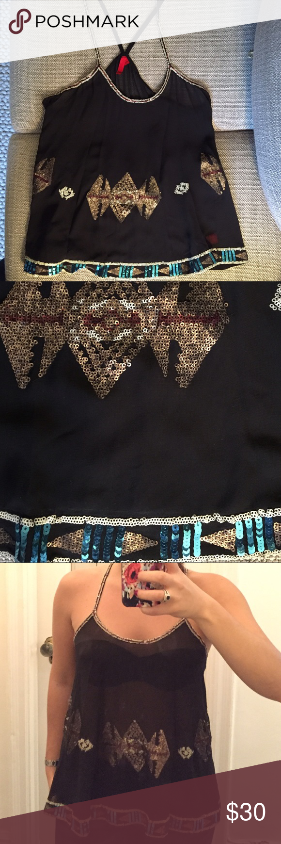 5|48 Saks Fifth Ave sheer sequin black top Beautiful sheer sequin tribal top with cross cross straps. Never worn- perfect condition! Saks Fifth Avenue Tops Tank Tops