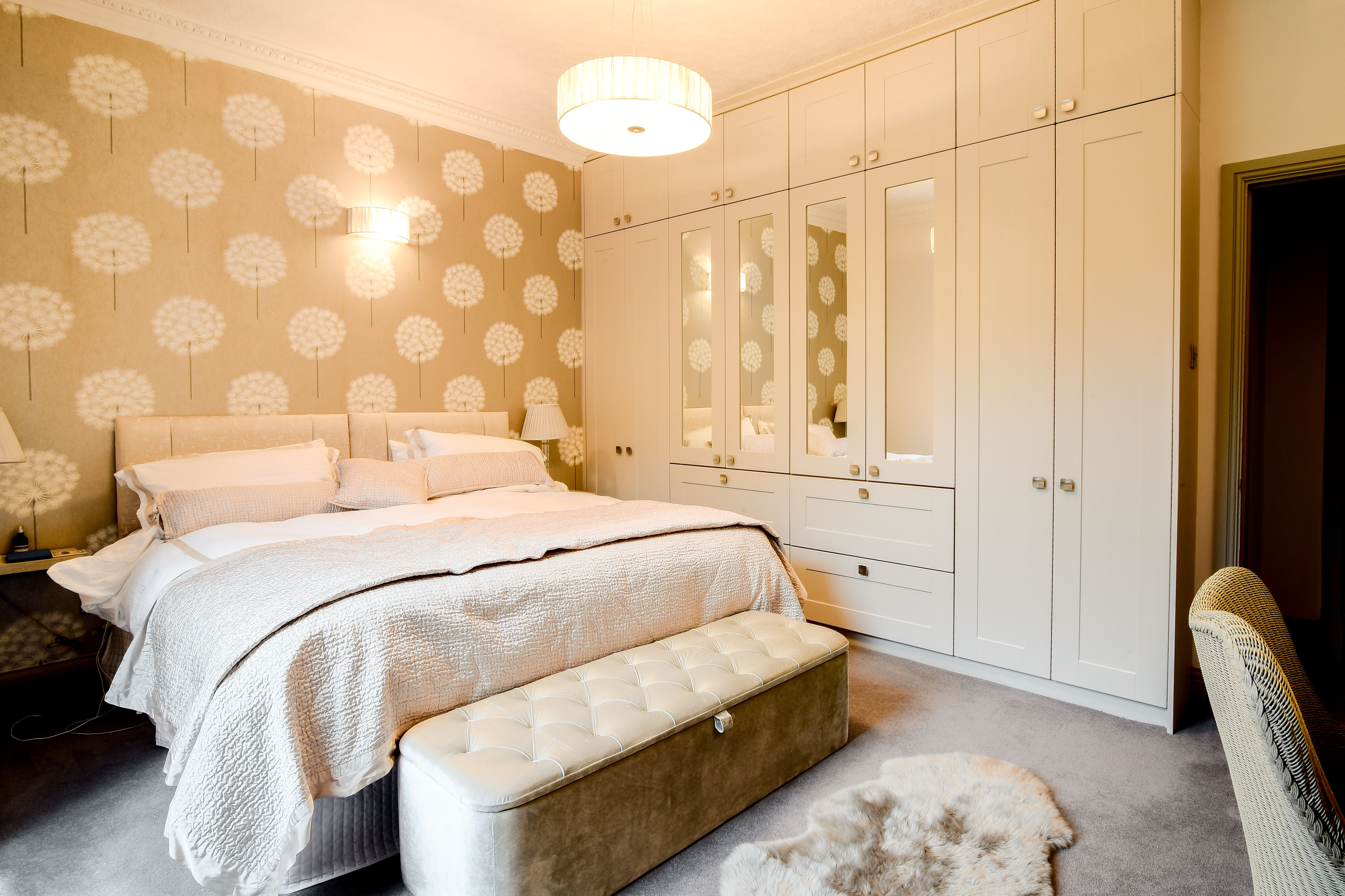 Beautiful cream bedroom with fitted wardrobes by AD3