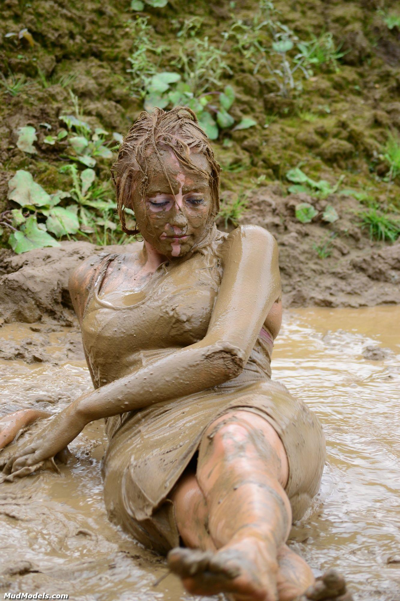 Man talking a nude mud bath