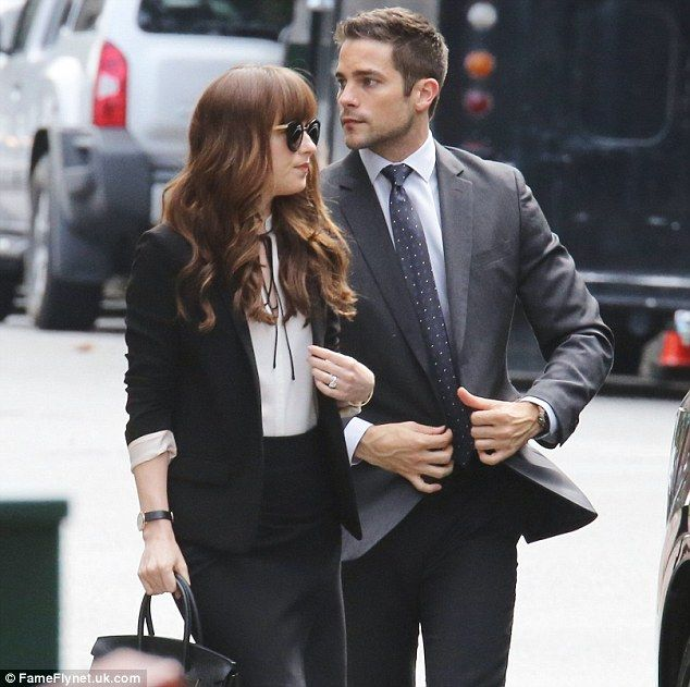 Looking good: Dakota added sunglasses to her ensemble as well; pictured with co-star Brant