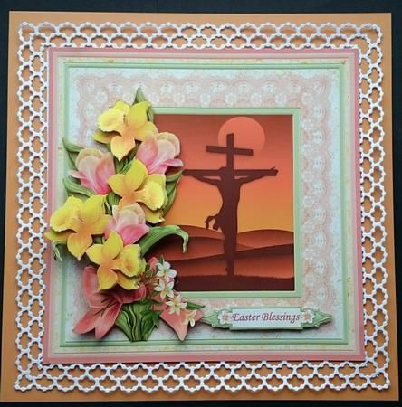 EASTER CRUCIFIXION & DAFFODILS 8x8 Decoupage Mini Kit by Sue Soules I printed the sheets onto satin photo paper. I cut out the main picture and created a die cut border frame around it.  Then attached it to an orange card blank . The decoupage was added using foam pads.