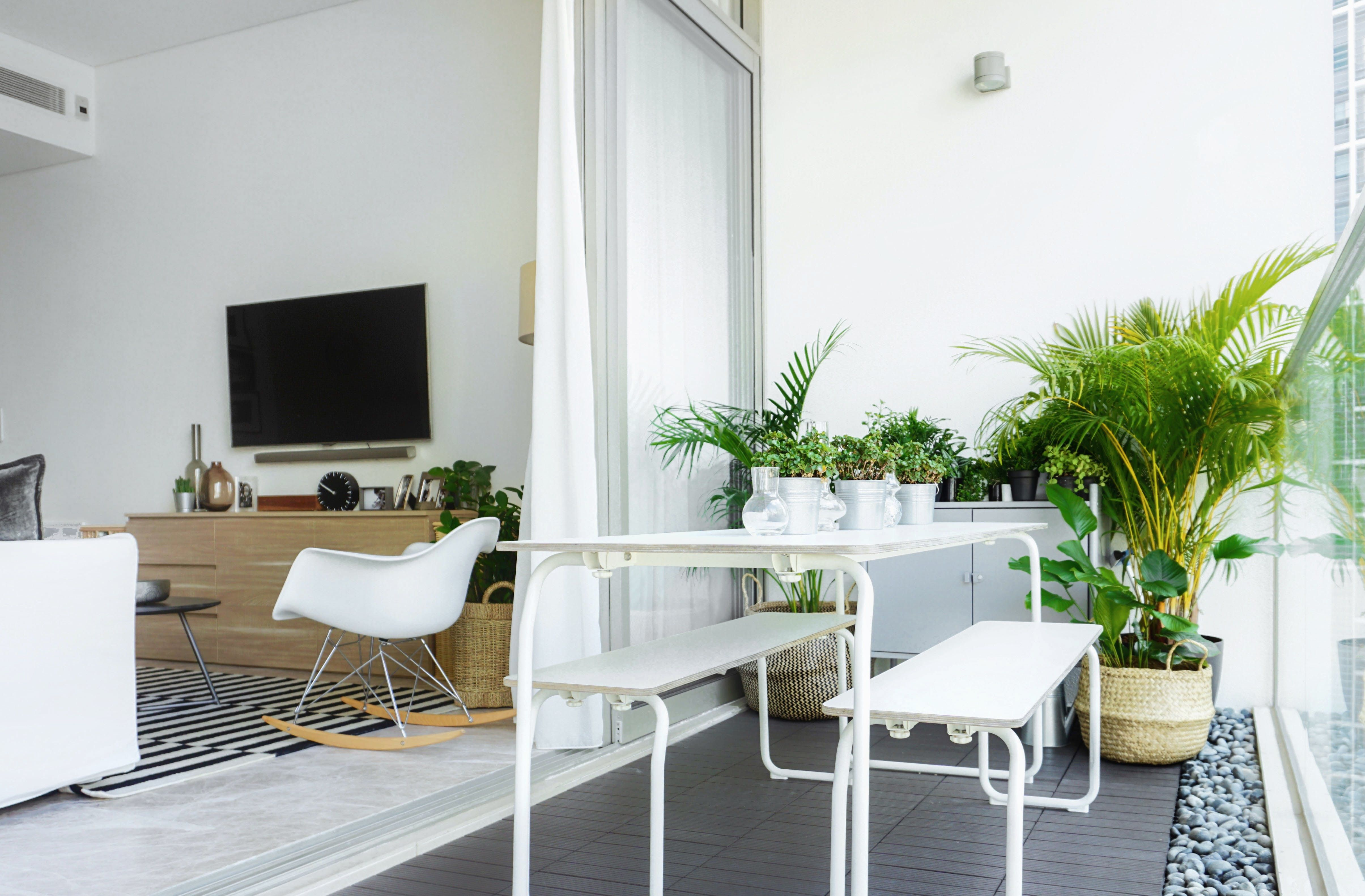 A Polished Condo In Singapore With Carefully Considered Clutter Condo Balcony Home Decor Outdoor Dining Area