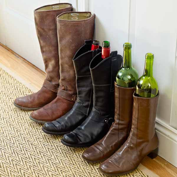empty wine bottles keeping tall boots from tipping over