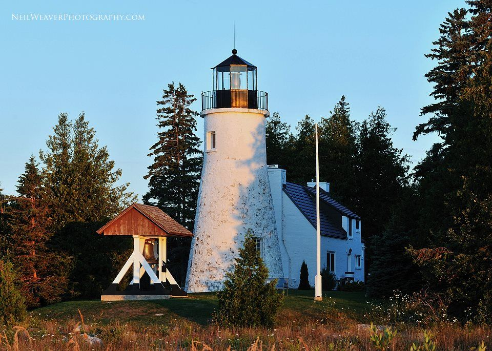 Sunrise at Old Presque Isle Lighthouse. The Lake Huron