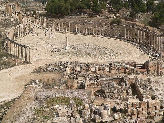 The nearly unique oval Forum at Jerash is surrounded by a fine colonnade, a long colonnaded street, two theatres (the Large South Theatre and smaller North Theatre), two baths, a scattering of small temples and an almost complete circuit of city walls. Most of these monuments were built by donations of the city's wealthy citizens.