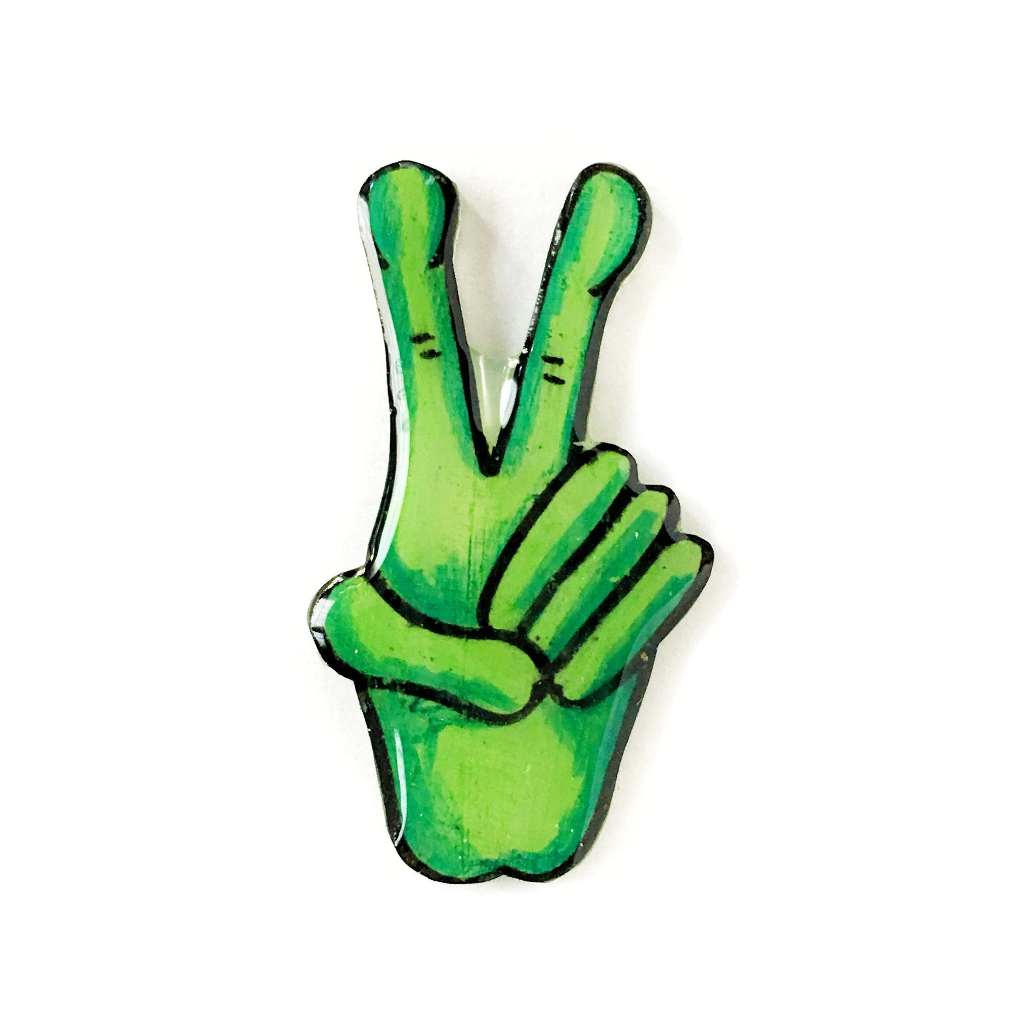 This is a hand drawn pin of a green alien hand giving the peace sign
