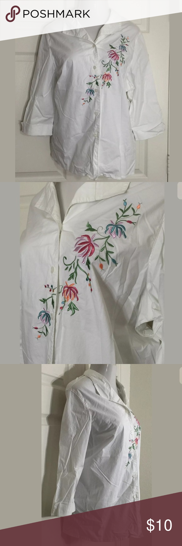 """Blair Floral Blouse Really pretty white with floral embroidered, button front blouse. Has 3/4 sleeves. Bust: 54""""; Length in the back from the shoulder: 29"""". 98% Cotton, 2% Spandex. Machine washable. Smoke free home. Thanks for shopping my closet 🌺! Blaire Tops Button Down Shirts"""