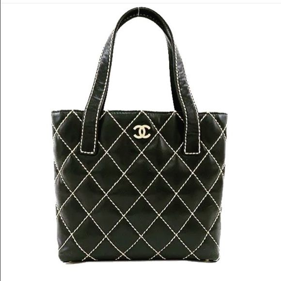 CHANEL *AUTHENTIC* BLACK LEATHER STITCH TOTE BAG CHANEL BLACK QUILTED STITCH CALFSKIN LEATHER. Fully lined CHANEL Monogram interior. Brushed gold tone hardware with magnet top closure. Comes with authenticity card and dust bag CHANEL Bags Totes