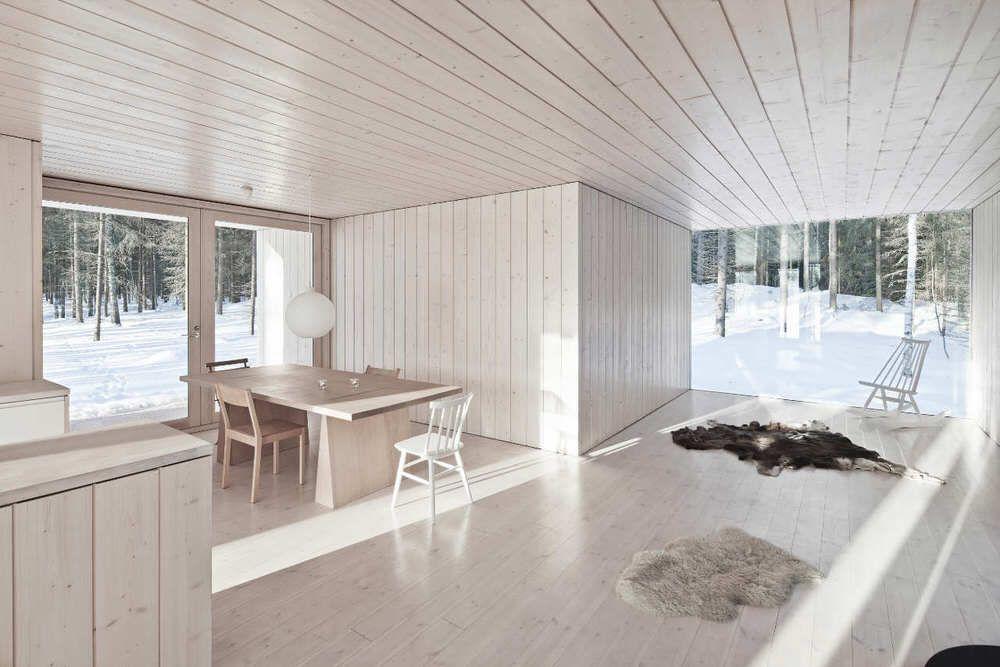 Finnish Interior Design minimalist interior design and full-wall windows of four cornered
