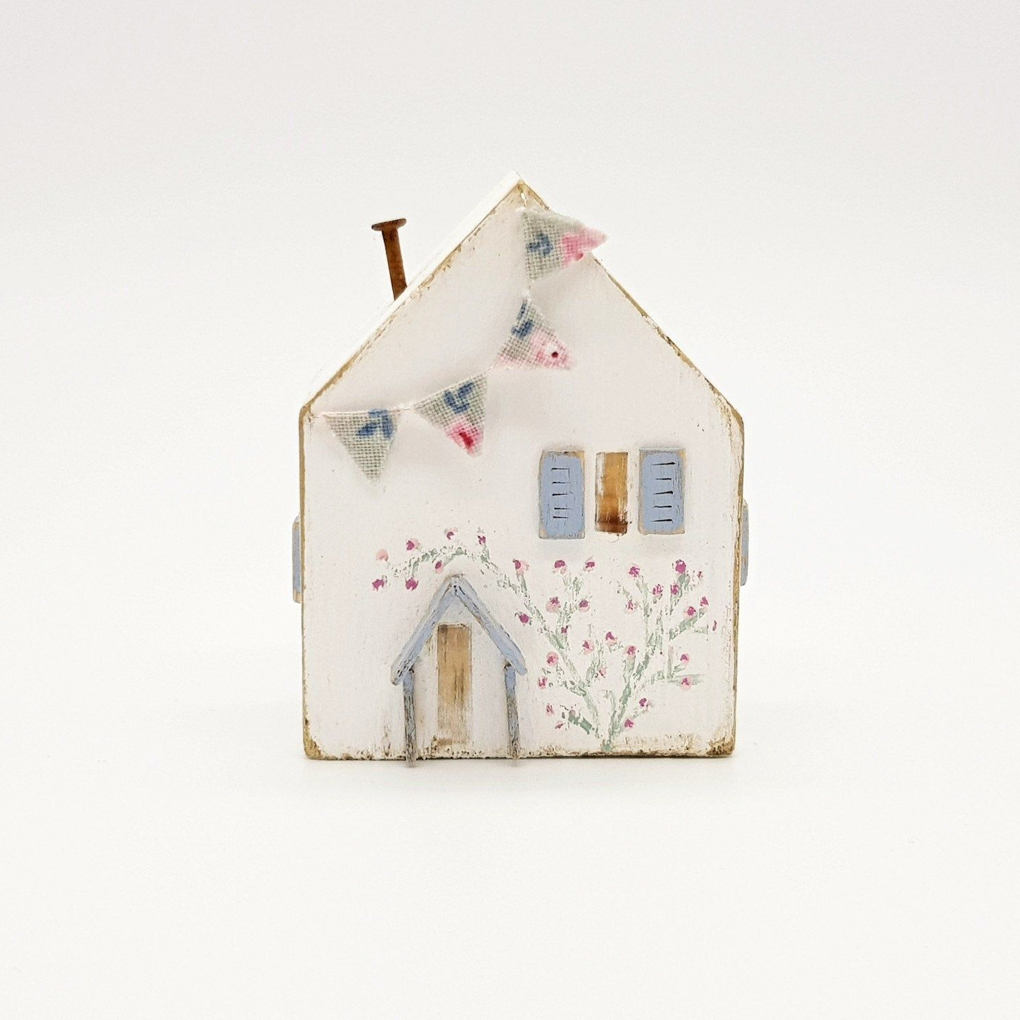 House With Nautically Themed Folk Art