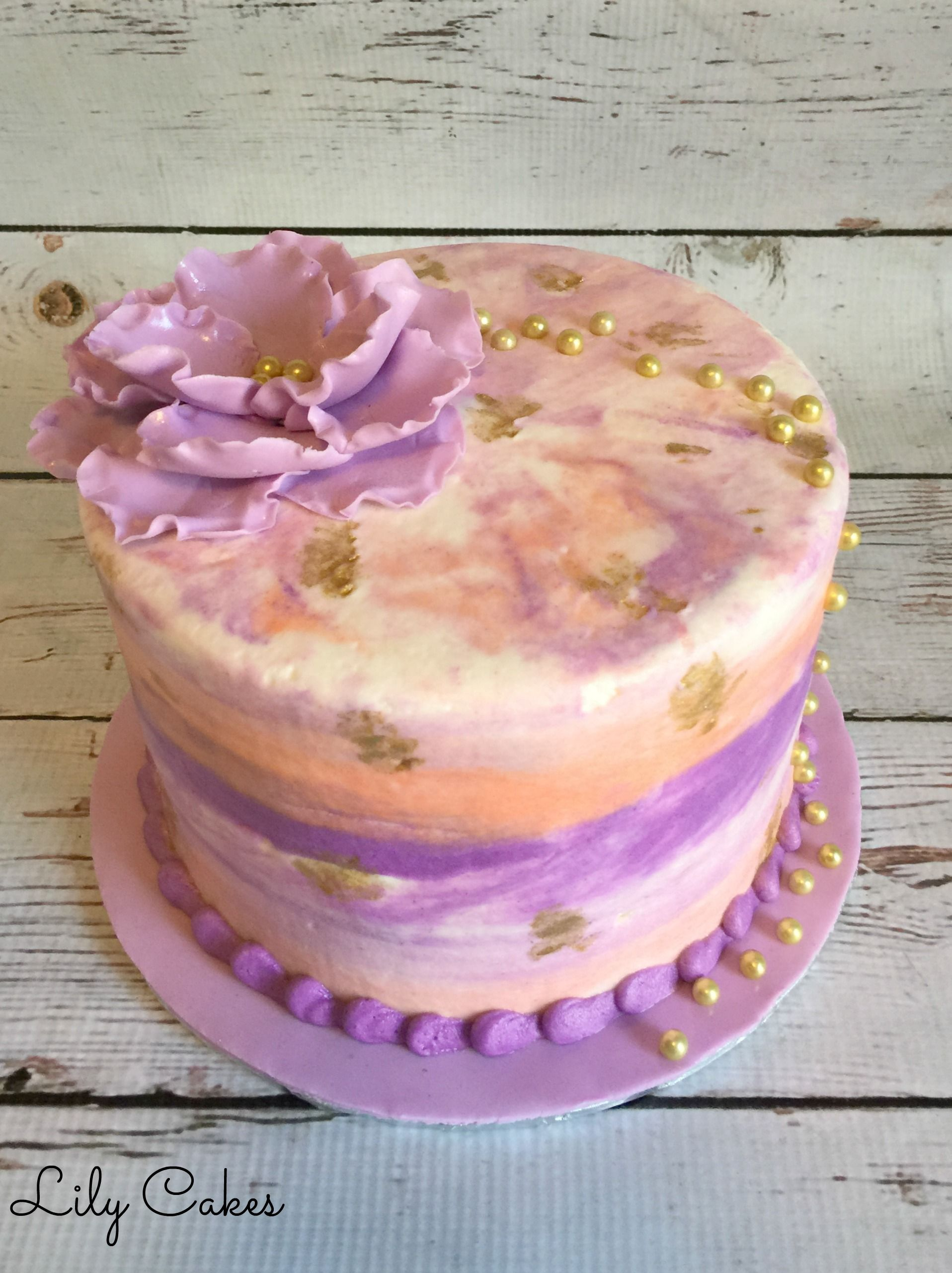 Butterecream water color cake in shades of pink, purple and peach ...