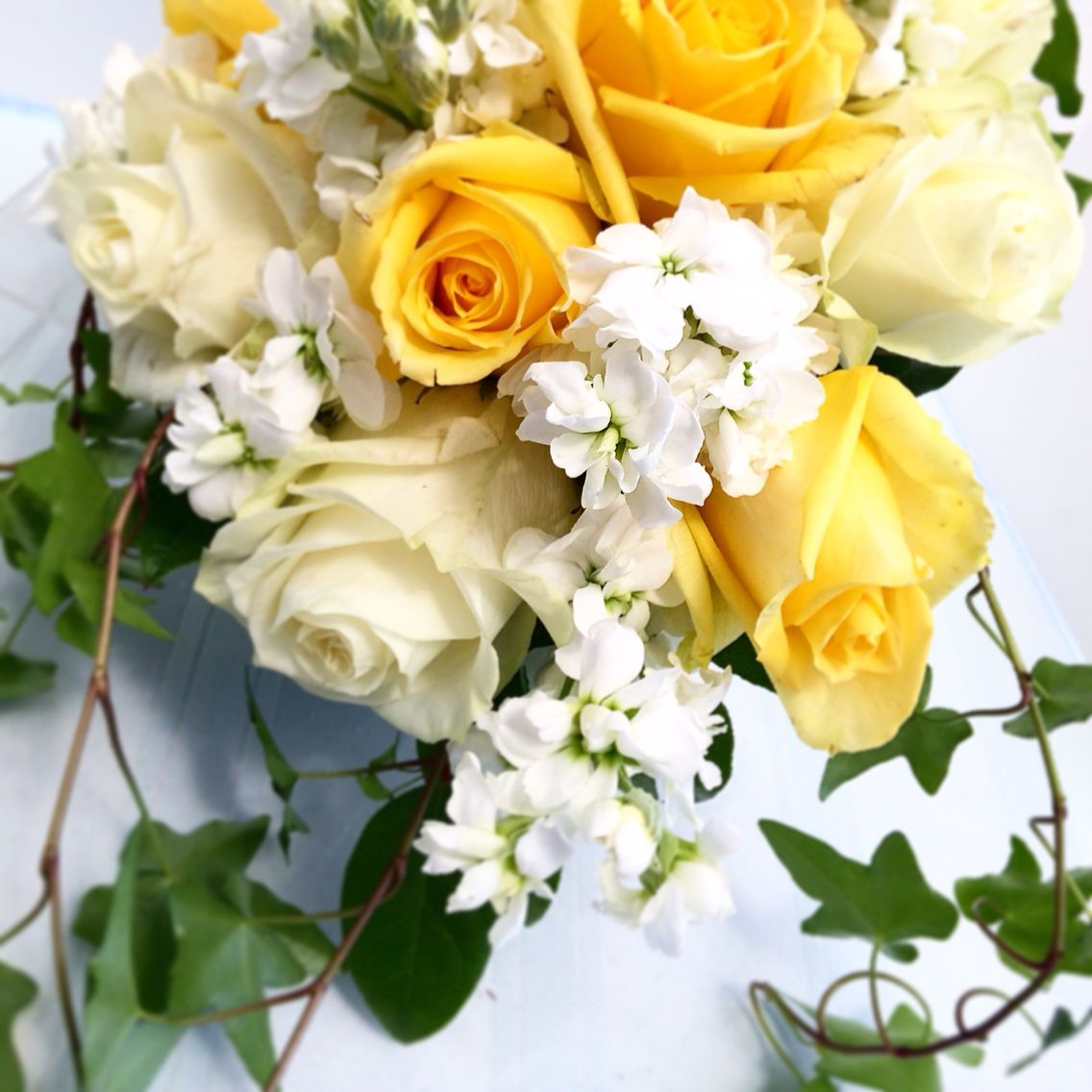 Yellow And White Roses With White Stock And Ivy Bouquet Jennifer