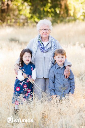 Grandma with her grandkids. Cute extended family photography pose idea.
