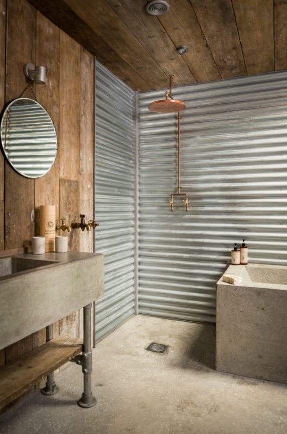 Bath With Corrugated Metal And Stone