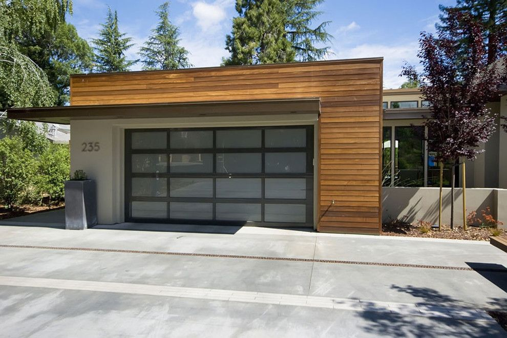 Mid century modern garage doors garage and shed for Contemporary garage apartment plans