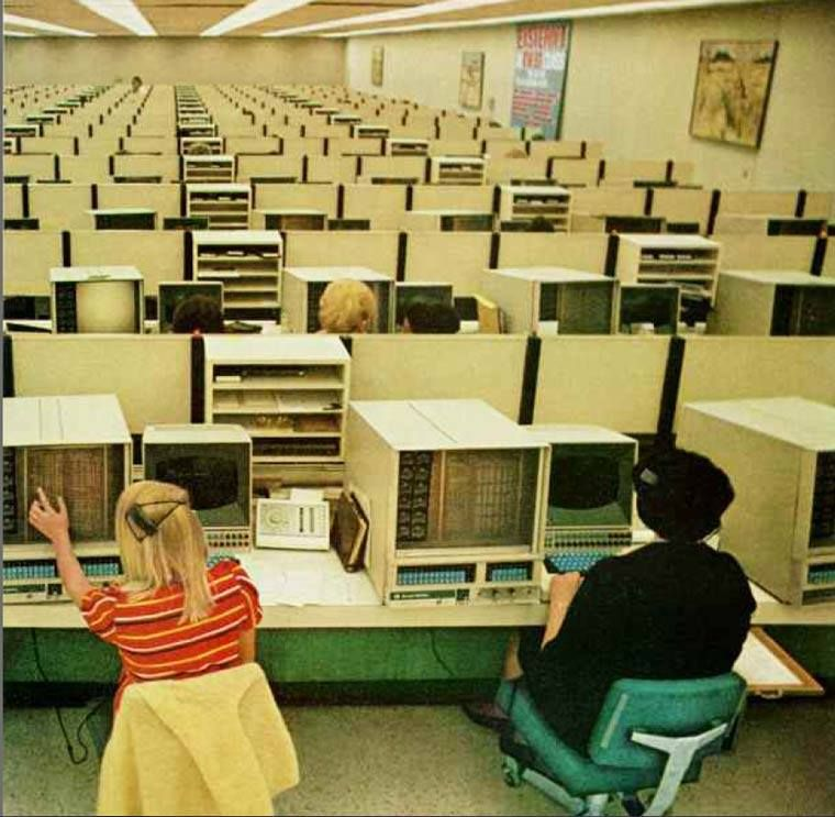 """""""1970s: Eastern Airlines operators man computers at the reservations center."""""""