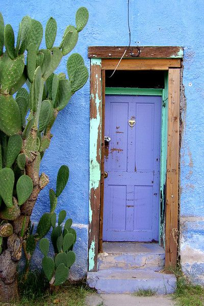 Tucson Home Exterior Blue Stucco And Purple Front Door