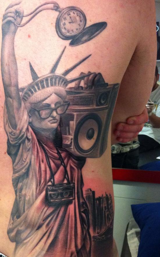 new york life statue of liberty back tattoo
