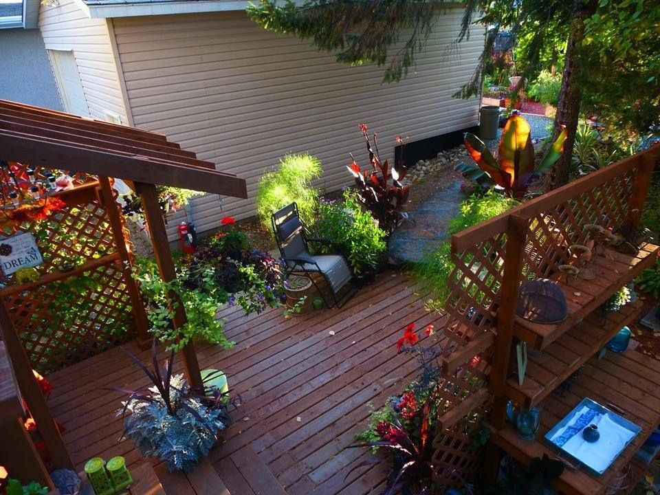 Birds eye view of finished back yard deck with arbor