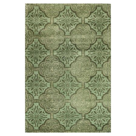 Add a pop of pattern to your living room or den with this hand-tufted wool rug, showcasing a classic medallion mosaic motif in green.   ...