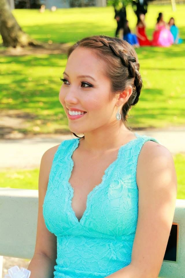 Headband braid then a low braid bun behind the right ear. Great prom hairstyle!