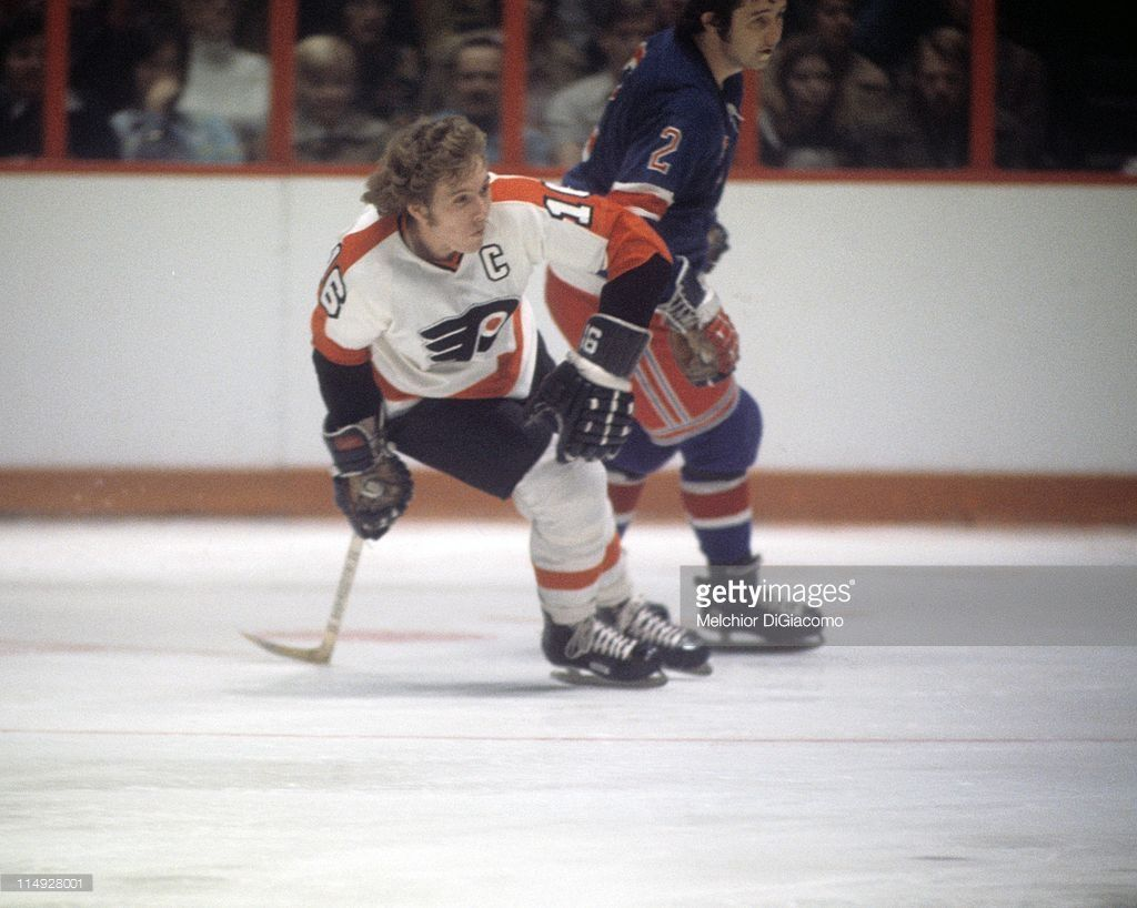 ae79ad34709 Bobby Clarke  16 of the Philadelphia Flyers and Brad Park  2 of the New  York Rangers skate on the ice during an NHL game circa 1975 at the Spectrum  in ...