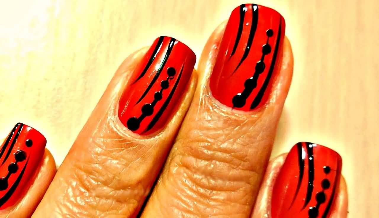 Nail Art Designs In Orange And Black To Bend Light