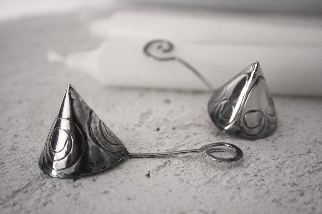 Kynttilänsammutin, hopeaa.