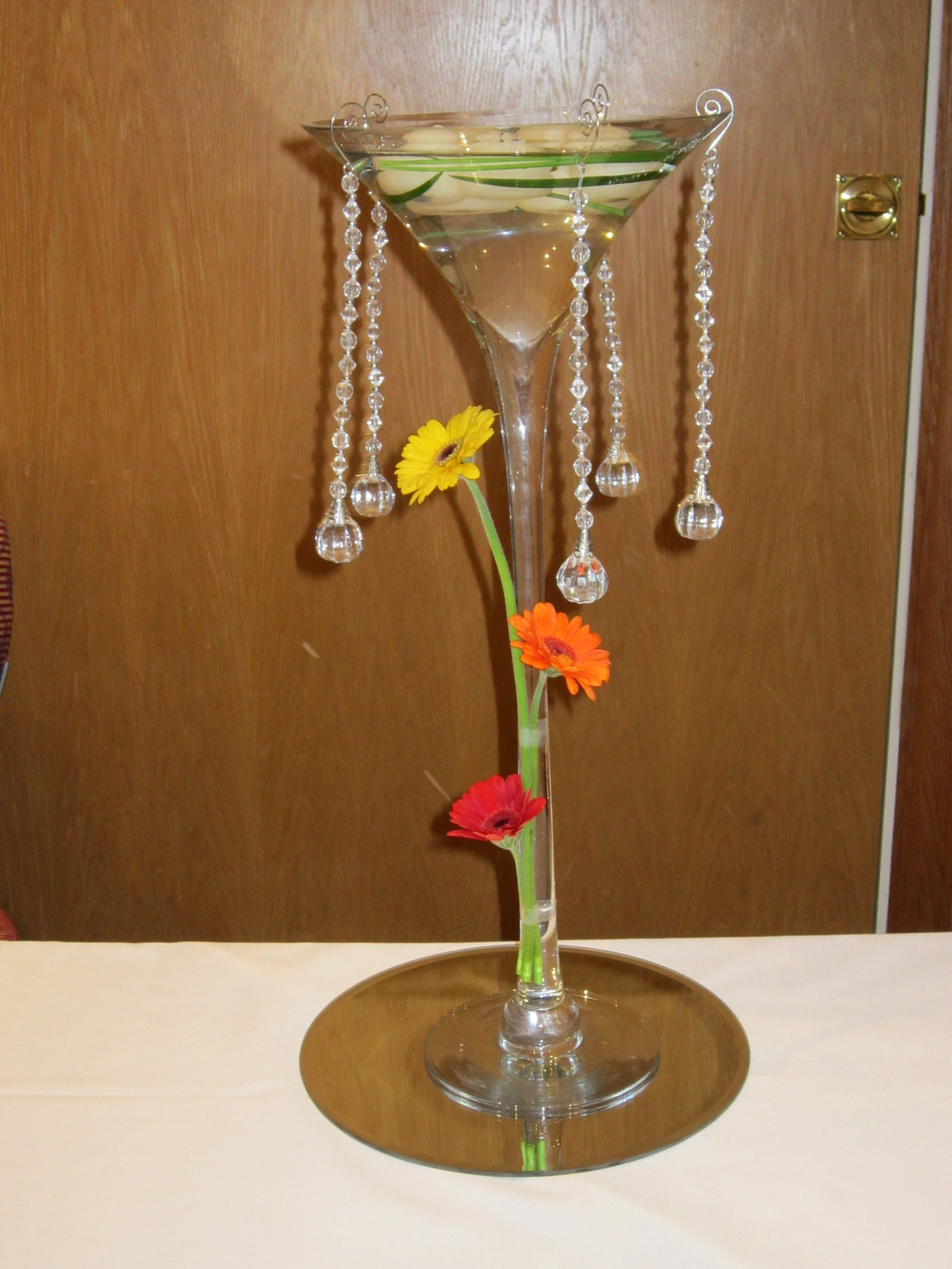 Martini vase display with floating candles gerberas and hanging