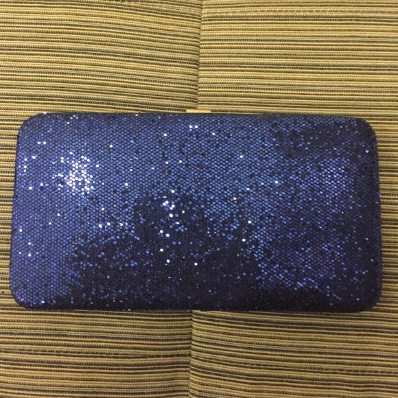 Blue Glitter Sparkle Holiday Formal Wallet Clutch Perfect for the holidays or New Years. Will fit the essentials without looking bulky. It has multiple compartments for cards and cash and even a small lip gloss or house key. Great as a wallet or clutch. Measures: 7.25 x 4. Thanks for looking! Amici Bags Clutches & Wristlets