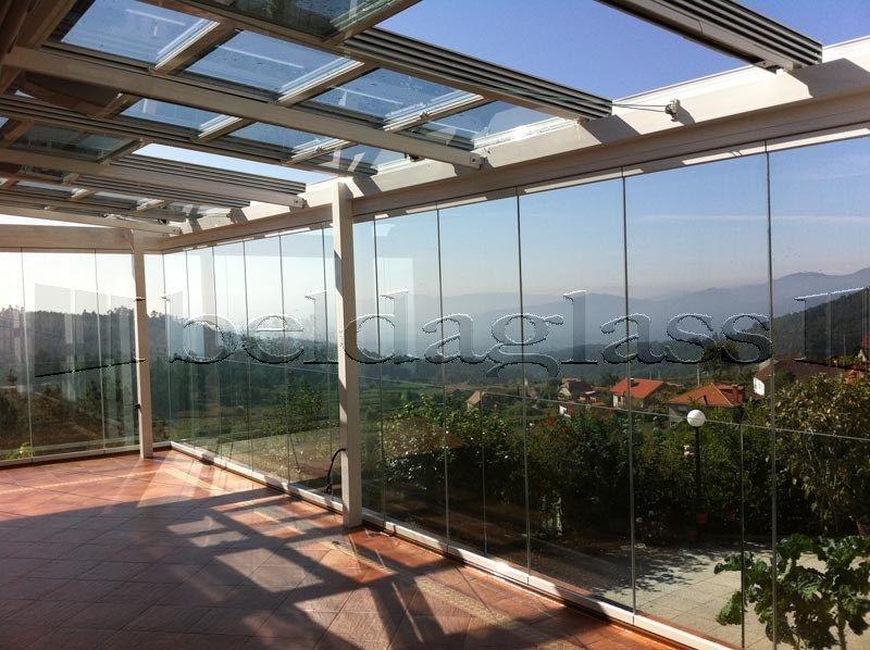 terraza cubierta con techo movil de cristal techos