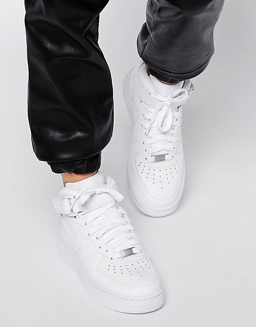 Shop Nike Air Force 1 07 Mid White Trainers at ASOS.