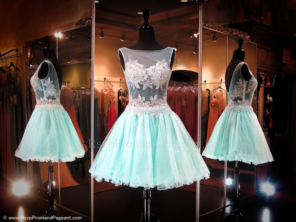 This sweet little dress is sleeveless featuring a sheer midrift and ...